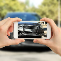 man-photographing-accident.jpg